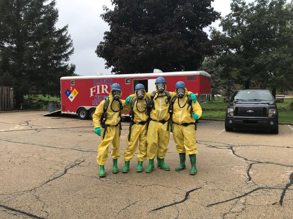 Four firemen in hazardous material